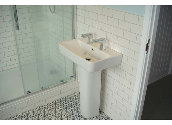 tiled wall with sink unit