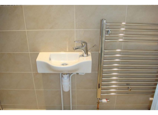 white sink and silver radiator