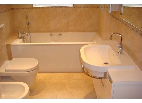 bath tub and white sink in Dover